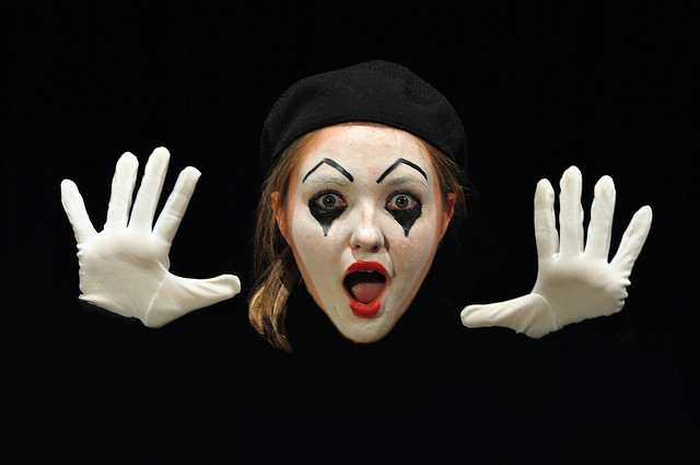 young beautiful girl dressed pantomime disguised mime clown play