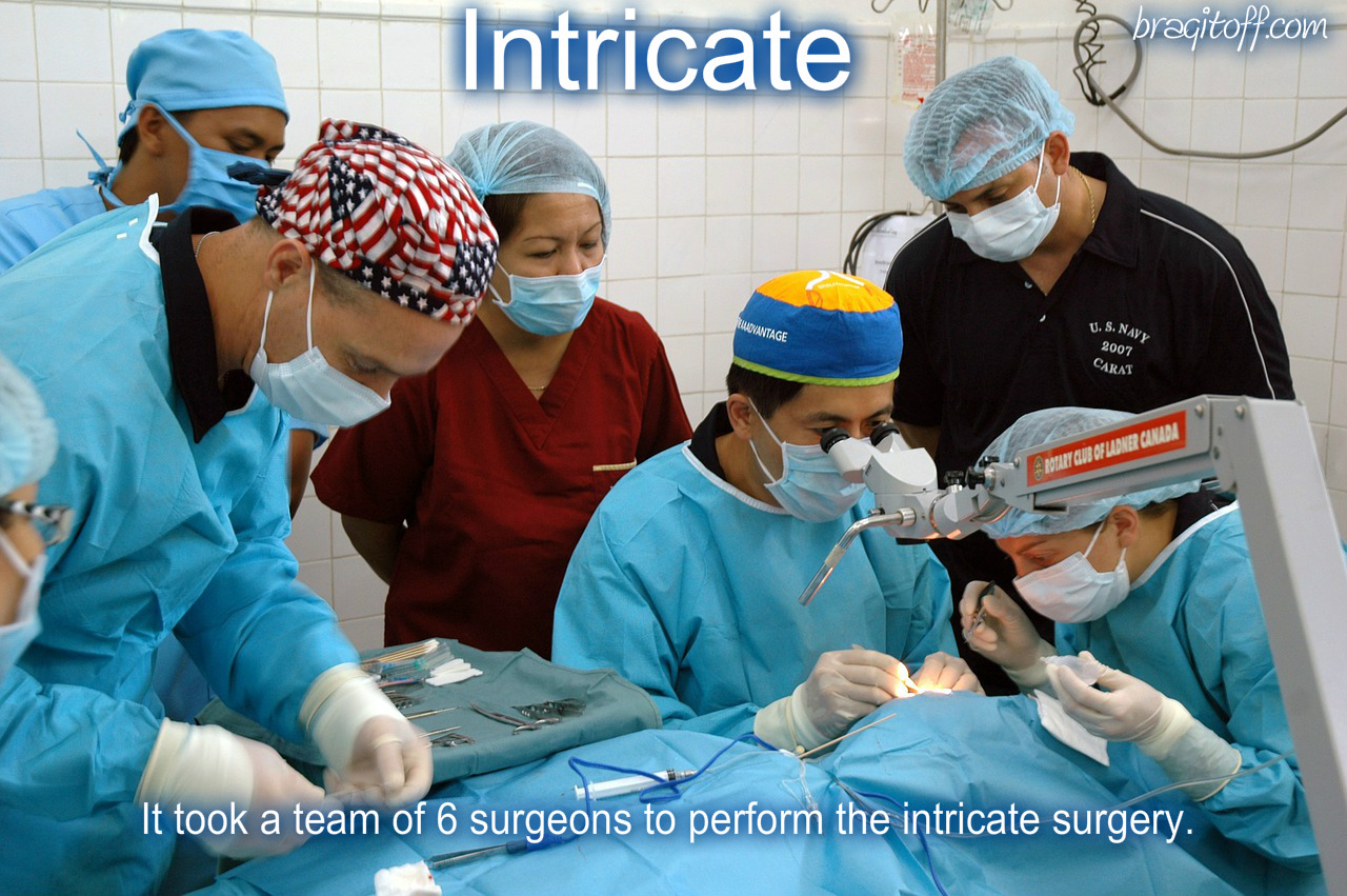 image sentence: It took a team of six surgeons to perform the intricate surgery.